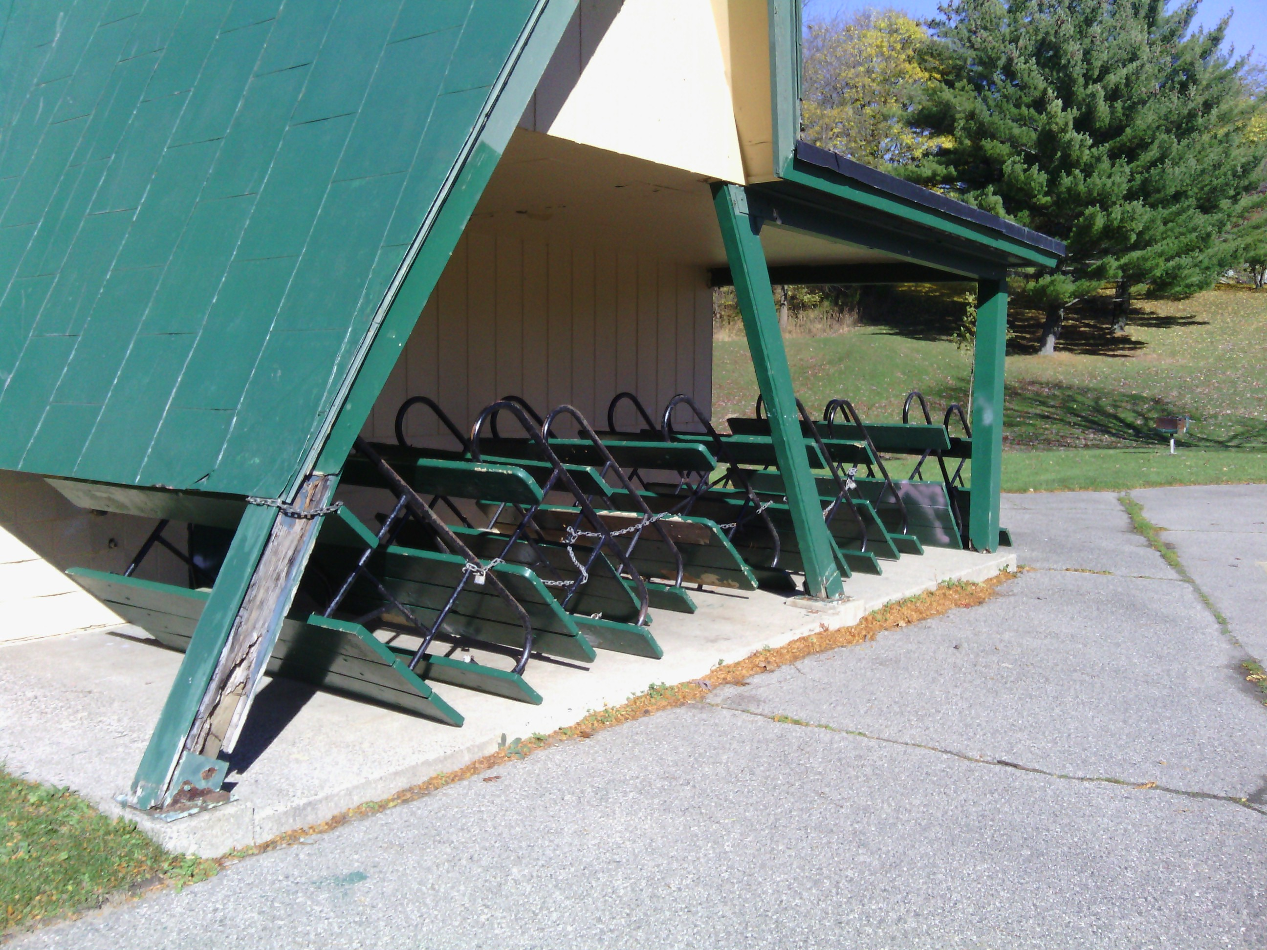 Overturned picnic tables in storage for the winter season